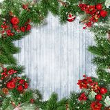 Christmas decorations with firtree, holly and Christmas wreath o stock photos