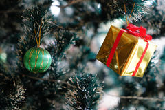 Christmas decorations focusing on ball hanging on pine tree Royalty Free Stock Photo