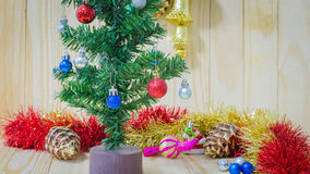 Christmas decorations focusing on red ball  on pine tree. On wooden background Stock Image