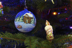 Christmas decorations in the form of a ball and candle Royalty Free Stock Images