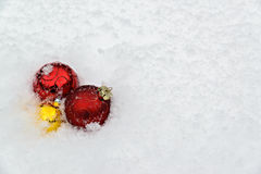 Christmas Decorations in Fresh Snow Royalty Free Stock Images