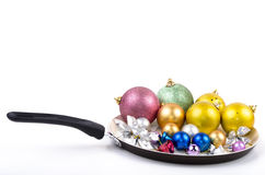 Christmas decorations on frying pan Stock Images