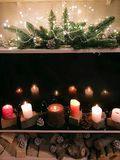Christmas decorations with a garland and candles Stock Photos