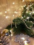 Christmas decorations with a garland and candles Stock Images
