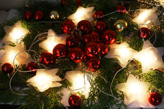 Christmas decorations. Garland in the form of stars and red balls Stock Image