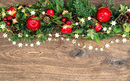 Christmas decorations garland with red apple and green pine bran Royalty Free Stock Images