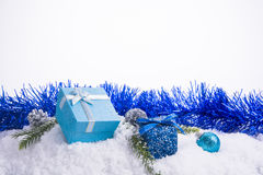 Christmas decorations - Gift box balls, pine cones and green bra Stock Images