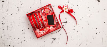 Christmas decorations in gift box over vintage background Royalty Free Stock Photo