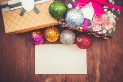 Christmas decorations with gift box and paper Royalty Free Stock Photos