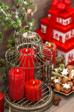 Christmas decorations, gift box, red candles, cookies, nuts Stock Photos