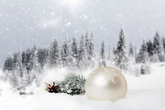 Christmas decorations and gift box in snow Stock Photo