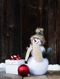 Christmas decorations and gift box in snow Royalty Free Stock Image