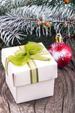 Christmas decorations and gift box on wood Royalty Free Stock Photography