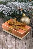 Christmas decorations and gift box on wood Stock Photography