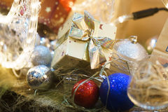 Christmas decorations, gift. New Year, Christmas tree balls decorations, gold box gift Royalty Free Stock Image