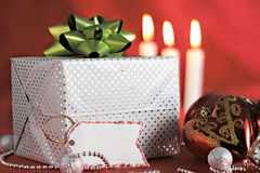 Christmas decorations and gift package with tag Royalty Free Stock Photography