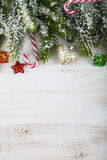 Christmas decorations, gifts and fir branches on a wooden table. Christmas decorations, gifts and fir branches in the snow on a wooden table. Christmas border Royalty Free Stock Photos