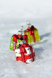 Christmas decorations - gifts on a snow Stock Images