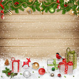 Christmas decorations and gifts on a wooden background Royalty Free Stock Photo