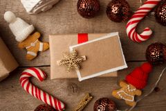 Christmas Decorations with Gingerbread man, candy cane, gift box with copy space, festive decorative toy. stock images