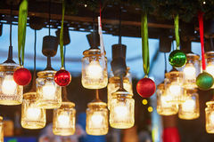 Christmas decorations and glass lanterns on Parisian Christmas market Royalty Free Stock Images