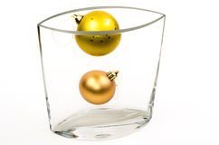 Christmas decorations in glass vase Stock Images
