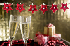 Christmas decorations and glasses of champagne Stock Photography