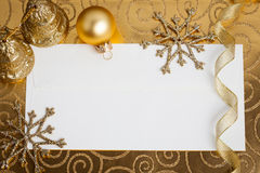 Christmas decorations on gold Royalty Free Stock Photography