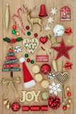 Christmas Collage with Decorations. Christmas decorations with gold glitter joy sign, new and old fashioned baubles with holly, mistletoe and  mince pies on oak Stock Image
