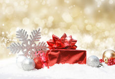 Christmas decorations on gold glittery background Stock Images