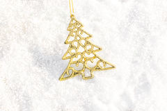 Christmas decorations gold xmas tree at snow ground outdoor. Royalty Free Stock Photo