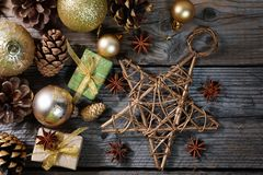 Christmas decorations with golden balls, gifts, pine cones and big star , horizontal banner. Top view royalty free stock photos