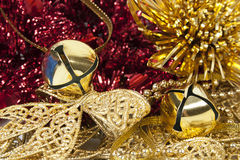 Christmas decorations golden bells and bows Stock Photos