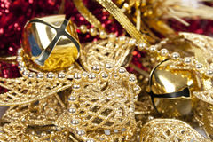 Christmas decorations golden bells and bows Royalty Free Stock Photos