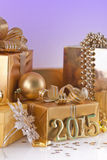 Christmas decorations and golden figures. Christmas decorations, gifts and gold figures Stock Photography