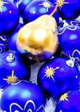 Christmas Decorations with a Golden Pear. Decorations photographed for Christmas project in a studio setting Royalty Free Stock Photography