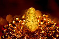 Christmas decorations 6. Golden pearls beautiful shiny in the  winter season Stock Images