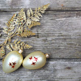 Christmas decorations: golden twig and balls Stock Images