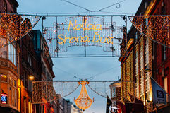 Christmas decorations on Grafton street in Dublin, Ireland. Dublin, Ireland - December 11, 2016: Christmas decorations on Grafton street in Dublin, Ireland. The Royalty Free Stock Photography