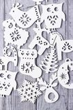 Christmas decorations on a gray wooden background. White Christmas decorations on a gray wooden background Royalty Free Stock Photo