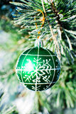 Christmas decorations green ball at xmas tree outdoor. Royalty Free Stock Images