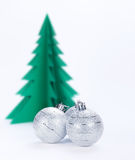 Christmas decorations and green paper tree. Stock Photo