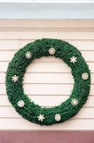 Christmas decorations with green round in a shop wall.  royalty free stock photos