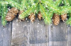 Christmas decorations, green and rustic. Christmas decoration with green Christmas twigs and cones Stock Photo