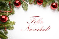 Christmas decorations with the greeting `Feliz Navidad!` in Spanish. Decoration made of fir branches and red Christmas ornaments with the greeting `Feliz Navidad royalty free stock photos