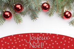 Christmas decorations with the greeting in French `Joyeux Noël` Merry Christmas! Royalty Free Stock Images