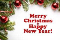 Christmas decorations with the greeting `Merry Christmas and Happy New Year!` Stock Images