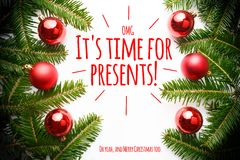 Christmas decorations with the greeting `OMG it`s time for presents! Oh yeah, and Merry Christmas too` Royalty Free Stock Images