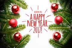 Christmas decorations with the greeting `Wishing you a happy new year 2017!` Royalty Free Stock Images