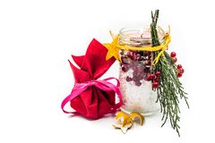 Christmas hand made candle with red berries craft and a gift isolated on white Royalty Free Stock Photos
